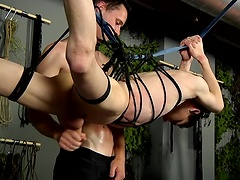 Restrained and hanging Aaron gets the cum drained from his cock by Aiden
